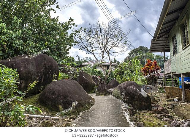 Kampung Gumbang houses with big stones by the sides where the Bidayuh (Land Dayak) stay, Sarawak, Malaysia