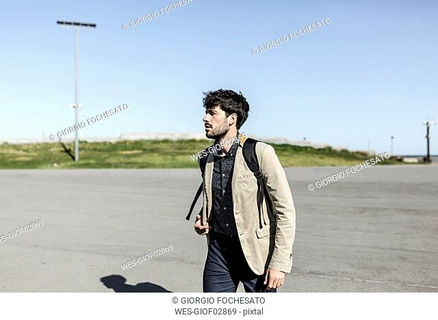 Young man with backpack outdoors