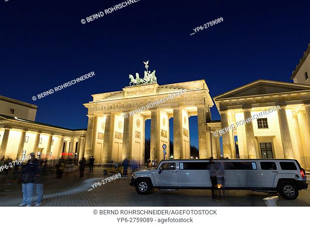 Brandenburg Gate and stretch limousine at night, Berlin, Germany