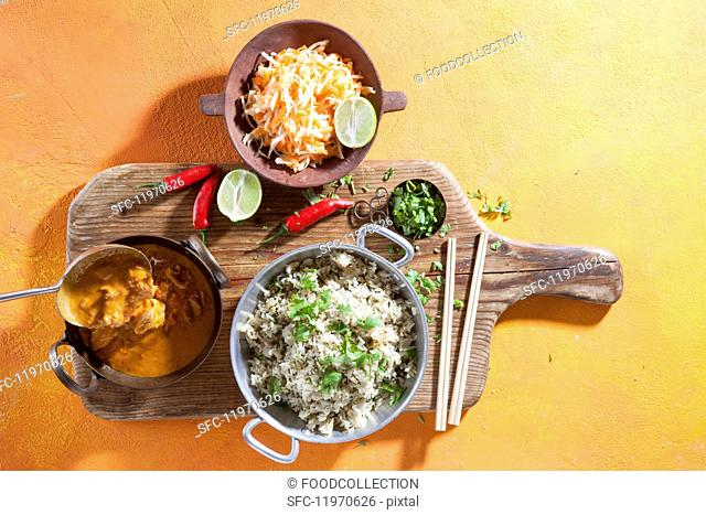 Red chicken curry with rice and salad (Asia)