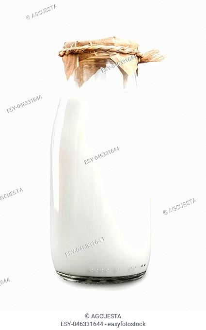 A bottle of fresh milk isolated on a white background closeup