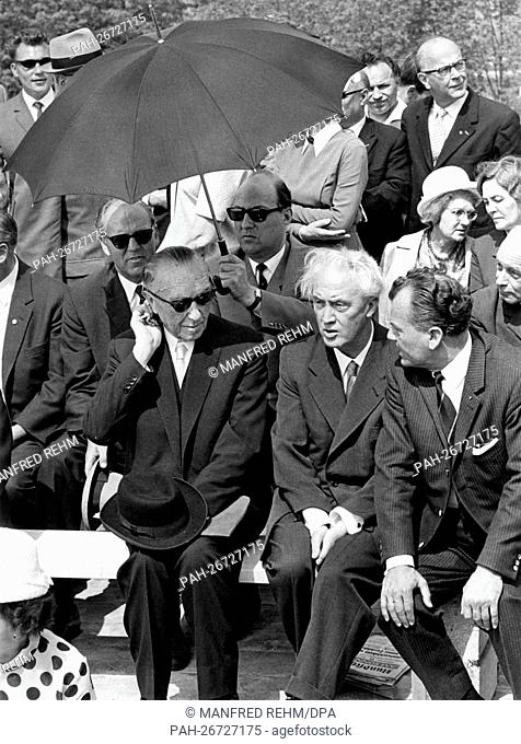 """Former German chancellor Konrad Adenauer (front row, l) watches the ceremonial act during the laying of the foundation stone for the """"""""Friedland memorial"""""""" on..."""
