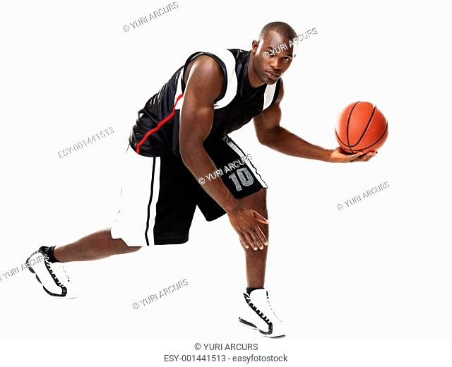Portrait of a cool male basketball player in action isolated on whte background