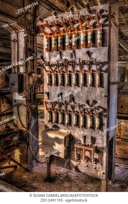 """Industrial Electrical Panel II - Rusted and no longer cared for but still standing. This electrical circuit panel is from the early 1900""""""""s"""