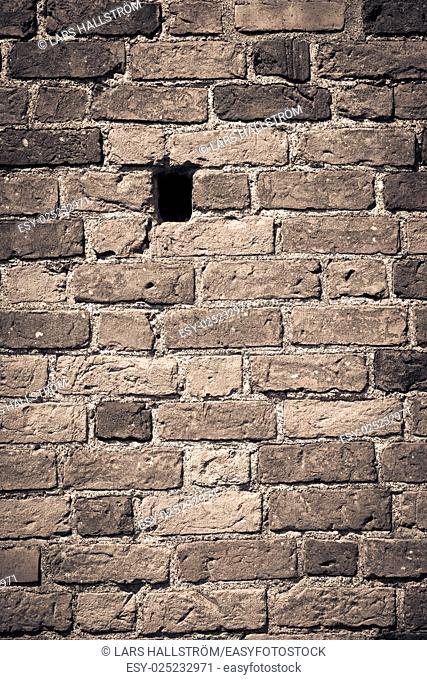 Empty brick wall with hole. Red bricks with nice texture. Background with copy space