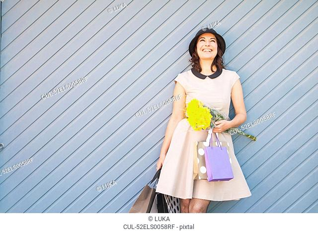 Woman holding shopping bags outdoors