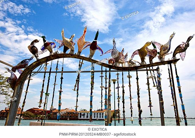Low angle view of sculptures with buildings in the background, Murano, Venetian Lagoon, Venice, Veneto, Italy
