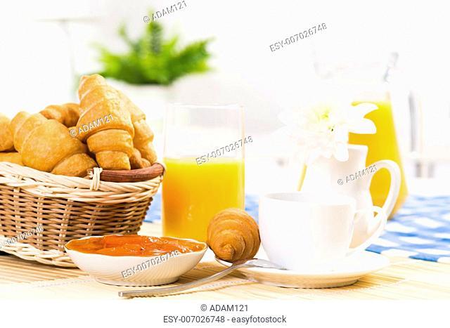 early breakfast, coffee, croissant, orange juice and jam