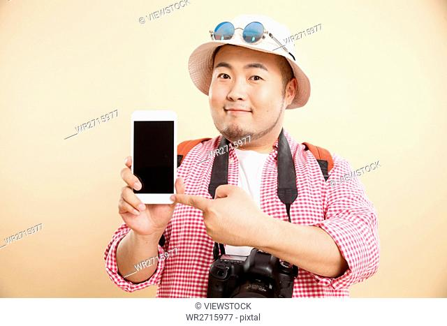Fat man holding a cell phone