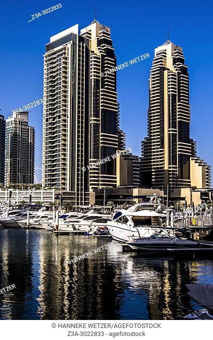 Supertall skyscrapers and a lot of boats at Dubai Marina, Dubai, UAE