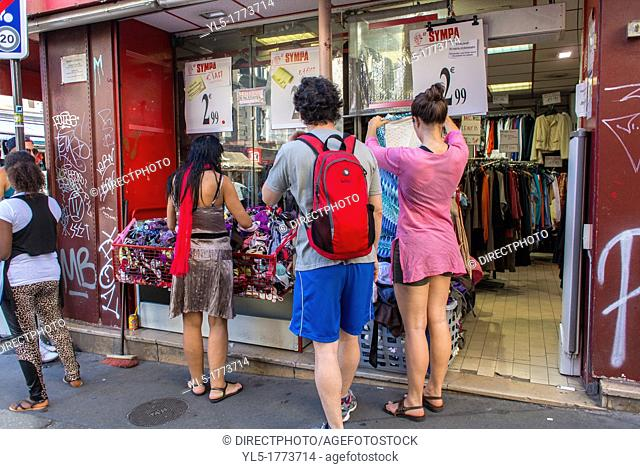 Paris, France, Teen Tourists Visiting Montmartre Area, Window Shopping, Low Cost Clothing Store