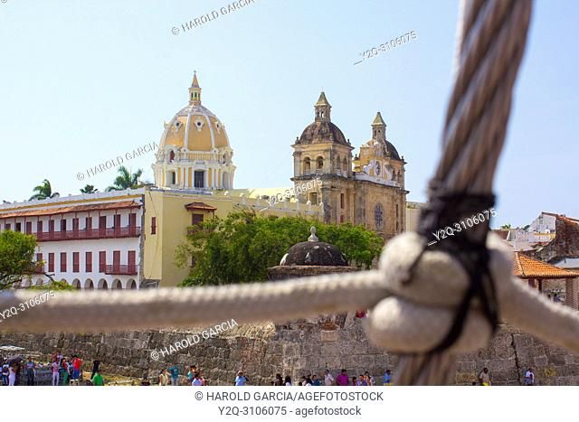 Out of focus close up of a vessel rope and the Dome of the Cathedral Basilica of St. Catherine of Alexandria in the ancient walled city of Cartagena de Indias