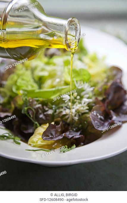 A mixed leaf salad drizzled with wild garlic oil