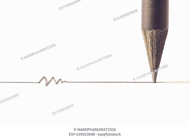 Close up Black pencil with stroke isolated on white background
