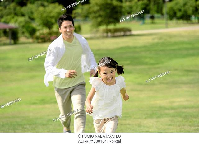 Kid with dad at the park