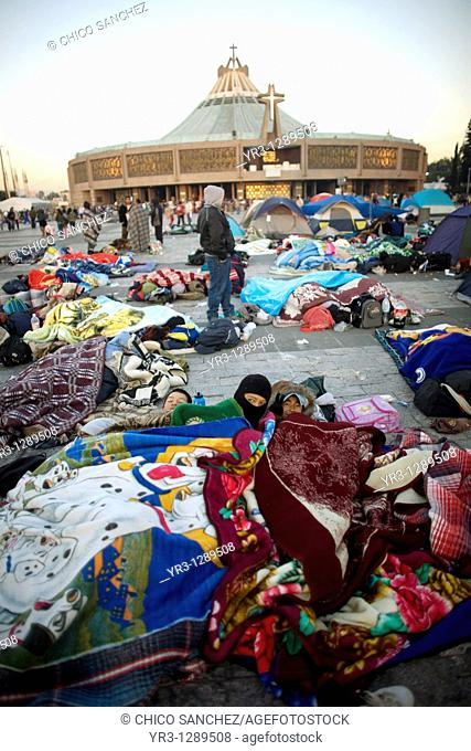 Pilgrims sleep outside the Our Lady of Guadalupe Basilica in Mexico City, December 11, 2010  Hundreds of thousands of Mexican pilgrims converged on the Basilica