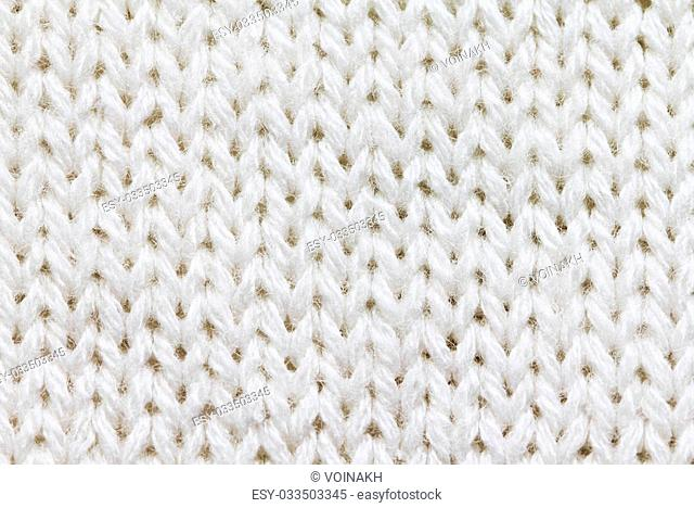 Knitted background of white color close up