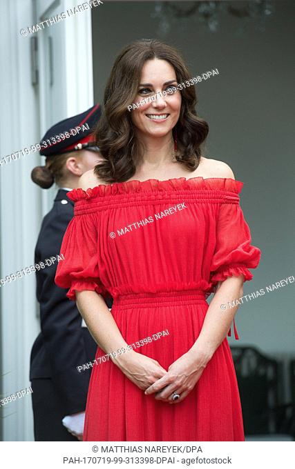 "Catherine, Duchess of Cambridge, wife of Britain's Prince William, arrives in the garden of the British ambassador's residence for the """"Queen's Birthday Garten..."