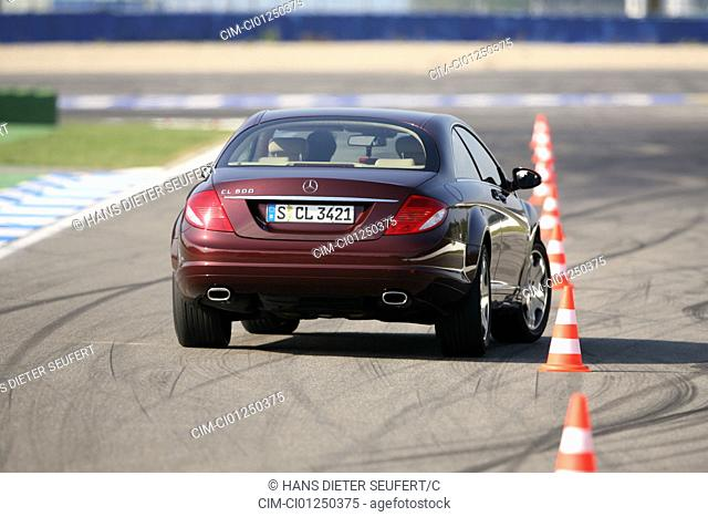 Mercedes CL 600, model year 2006-, ruby colored, driving, diagonal from the back, rear view, test track, Pilonen