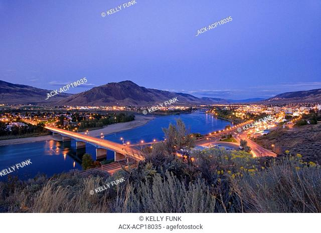 Sage brush creates the foreground for a dynamic dusk scene over Kamloops, British Columbia, Canada
