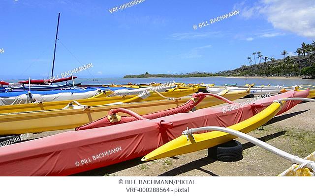 Honolulu Hawaii Oahu Outrigger canoes at Maunalua Bay in South Oahu yellow speed canoe