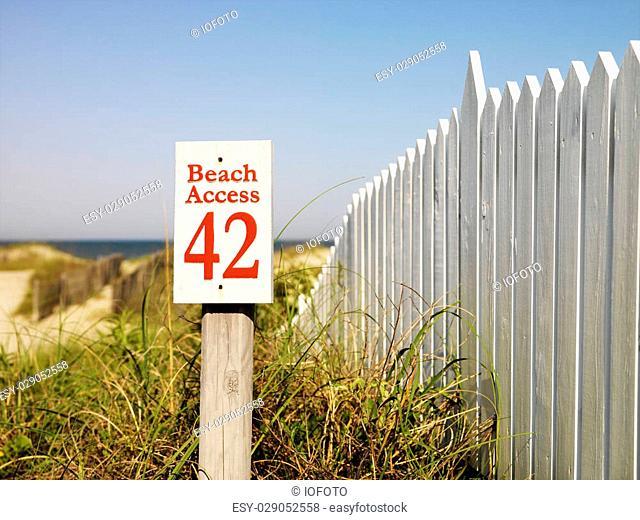Beach access sign with picket fence at Bald Head Island, North Carolina