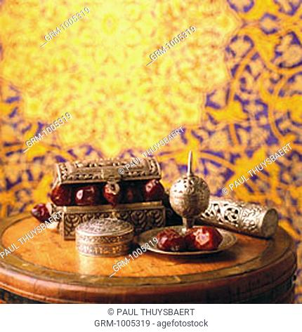 Box with dried dates and incense burner