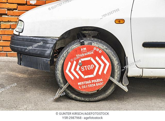 A car in the parking prohibition zone is secured with a wheel clamp, Bratislava, Slovakia, Europe