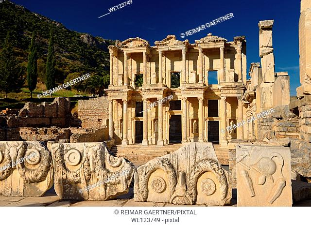 View of ruins surrounding the Library of Celsus from the Marble Street in ancient Ephesus Turkey