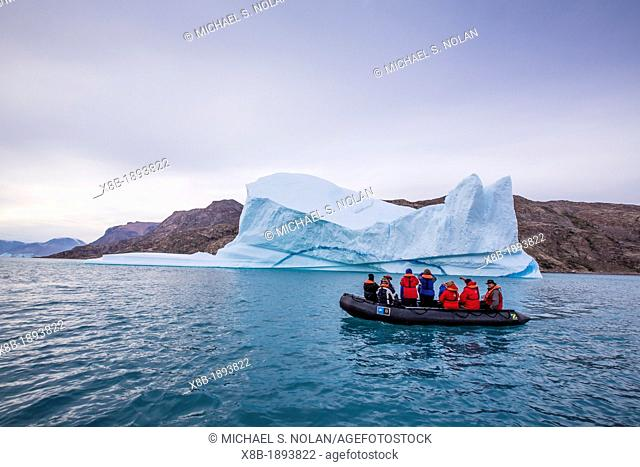 Zodiacs from the Lindblad Expeditions ship National Geographic Explorer amongst grounded icebergs in Sydkap, Northeast Greenland