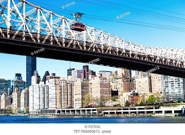 USA, New York State, New York City, Manhattan, City panorama with Queensboro Bridge over East River in foreground
