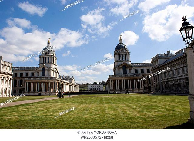 Old Naval College in Greenwich, UK with park and Greenwich Observatory in the background